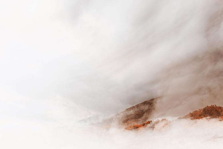 Free Stock Photo of Blinding Amber Mountain Fog Created by Nicolas Raymond