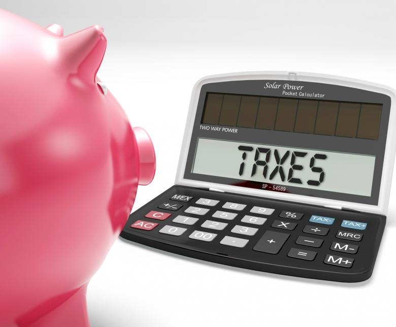 Taxes On Calculator Shows Income Tax Return - Free Tax Stock Photos