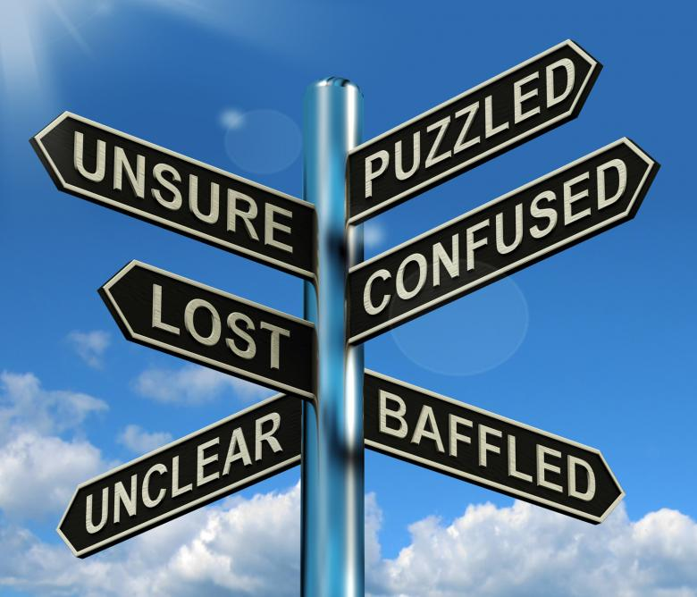 Free Stock Photo of Puzzled Confused Lost Signpost Showing Puzzling Problem Created by Stuart Miles