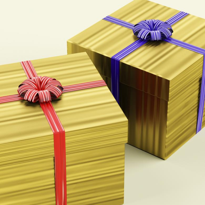Free Stock Photo of Gold Gift Boxes With Ribbon As Birthday Present Created by Stuart Miles