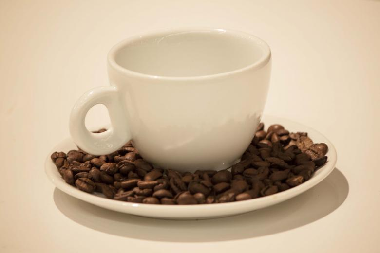 Free Stock Photo of White Coffee Cup with Beans Created by Eduardo Soares Bogosian