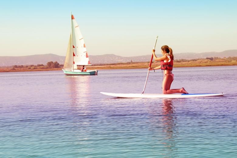 Free Stock Photo of Watersports - Girl Practicing on Paddle Board Created by Jack Moreh