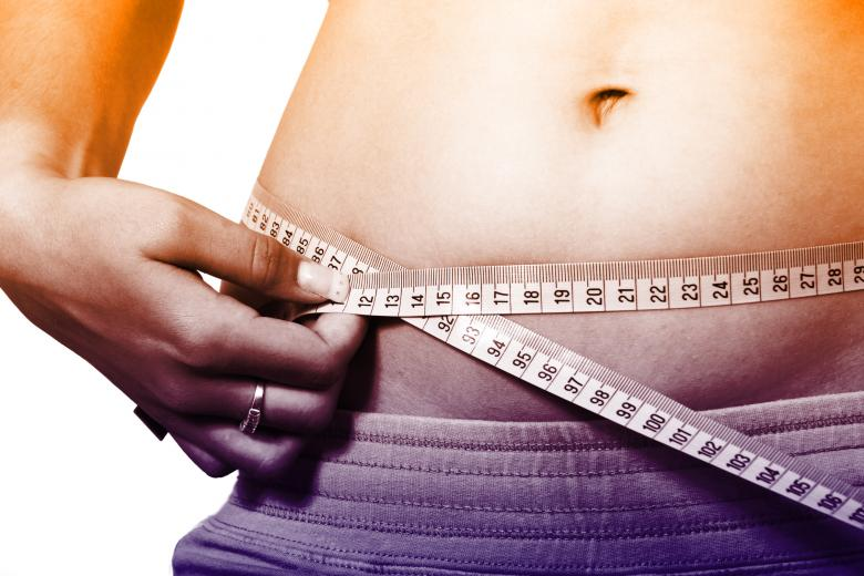 Woman Measuring Waistline - How to Lose Weight Fast - Free Fitness Stock Photos