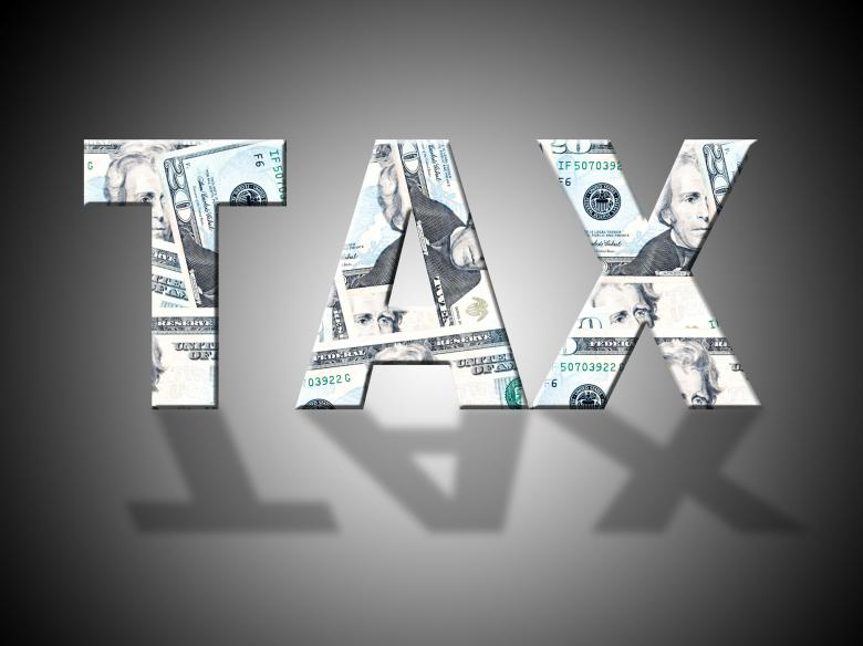 Tax Letters Shows American Dollars And Cash - Free Tax Stock Photos