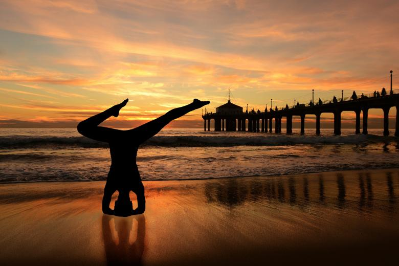 Yoga Pose Silhouette by the Sea - Free Yoga Stock Photos