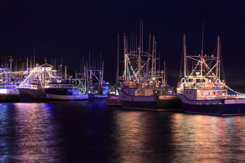 Free Stock Photo of Atlantic Canada fishing boats with Christmas lights  Created by Geoffrey Whiteway - Atlantic Canada Fishing Boats With Christmas Lights - Free Stock