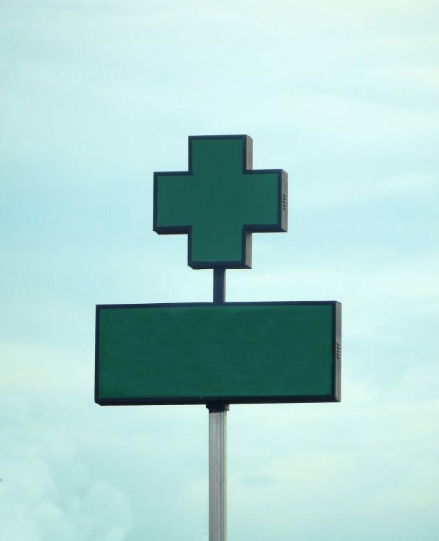 Free Stock Photo of Blank hospital green cross sign against a sky background Created by Ivan
