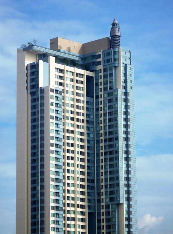 Free Stock Photo of Generic high-rise condominium building against a blue sky background Created by Ian L