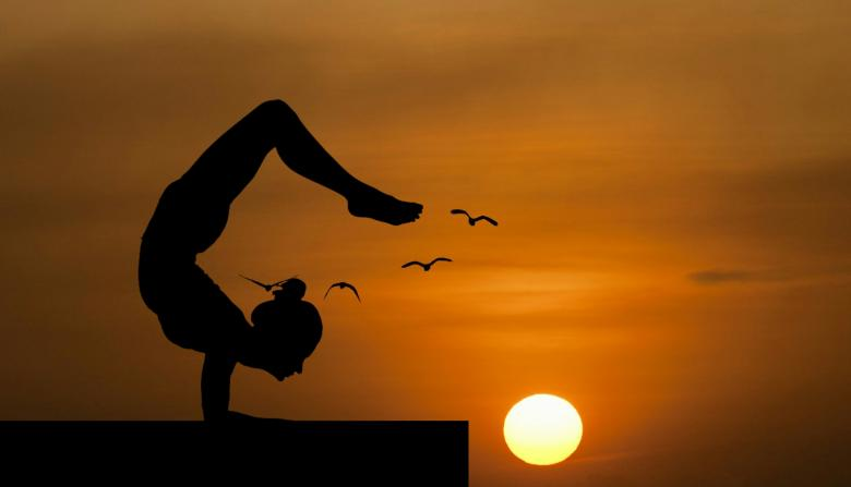 Yoga Pose Silhouette At Sunset