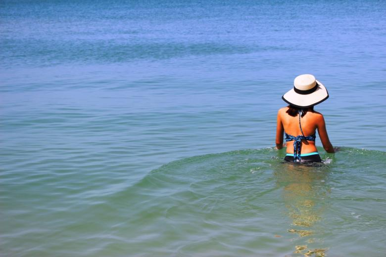 Free Stock Photo of A young woman on holiday walks and relaxes in the shallows of a tropic Created by Ivan