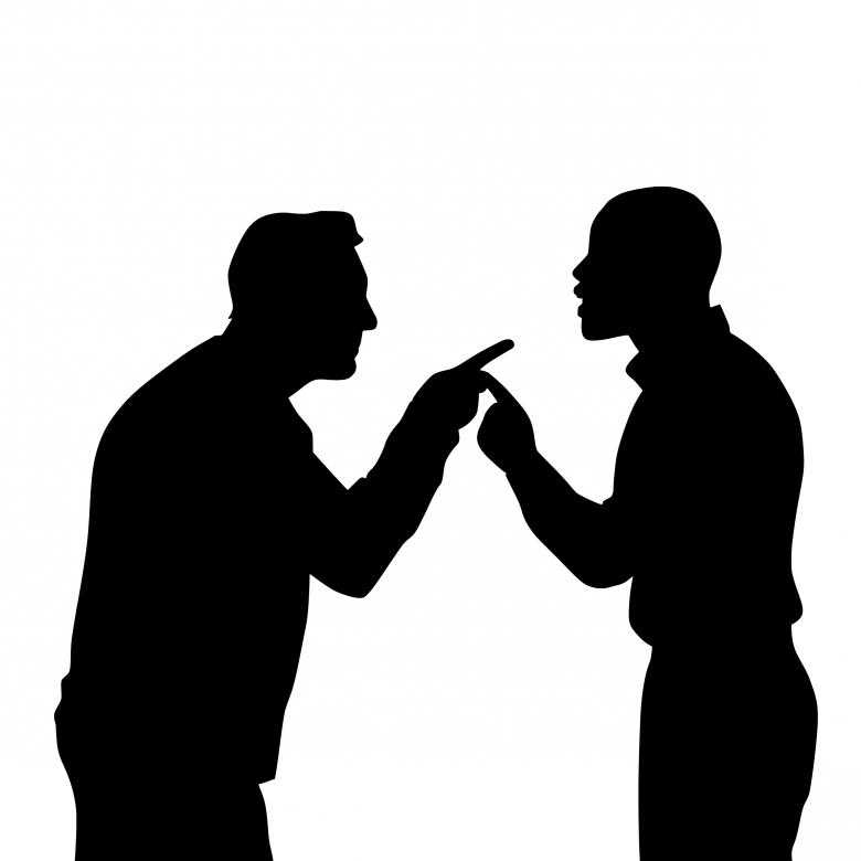 Silhouette of two men pointing and arguing