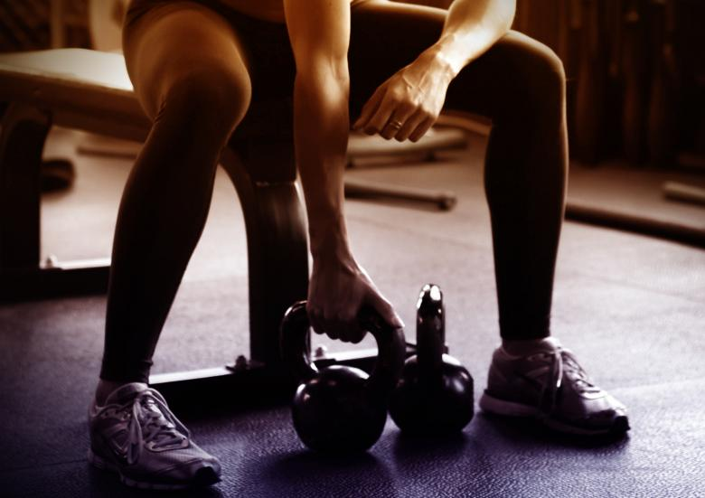Free Stock Photo of Woman Lifting Kettlebells Created by Jack Moreh