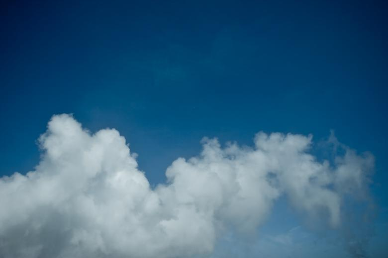Free Stock Photo of Geothermal Smoke Clouds on Blue Sky Created by Bjorgvin