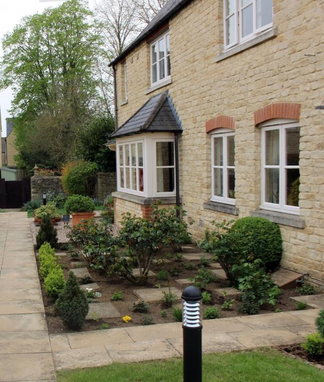 English Village Style Stone Houses With Courtyard Gardens