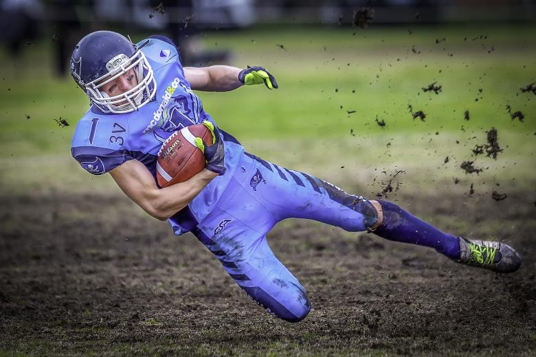 Free Stock Photo of Gridiron Football Player - Falling Down Created by John Torcasio