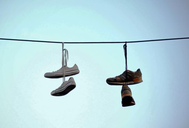Free Stock Photo of Shoes Hanging on a Wire Created by Mircea Iancu