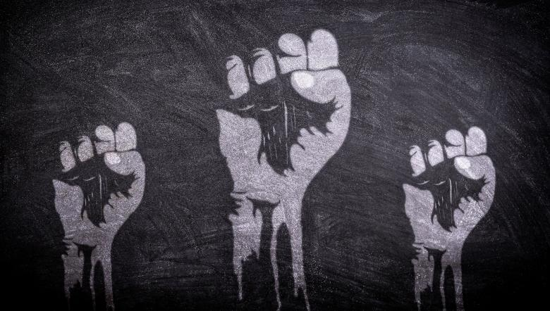 Free Stock Photo of Power to the People - Raised Fists on Blackboard Created by Jack Moreh