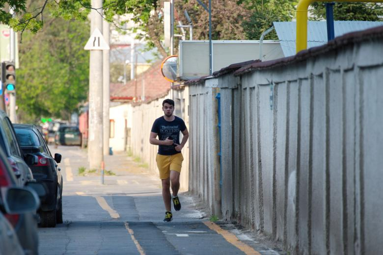 Free Stock Photo of Boy running on the streets Created by Mircea Iancu