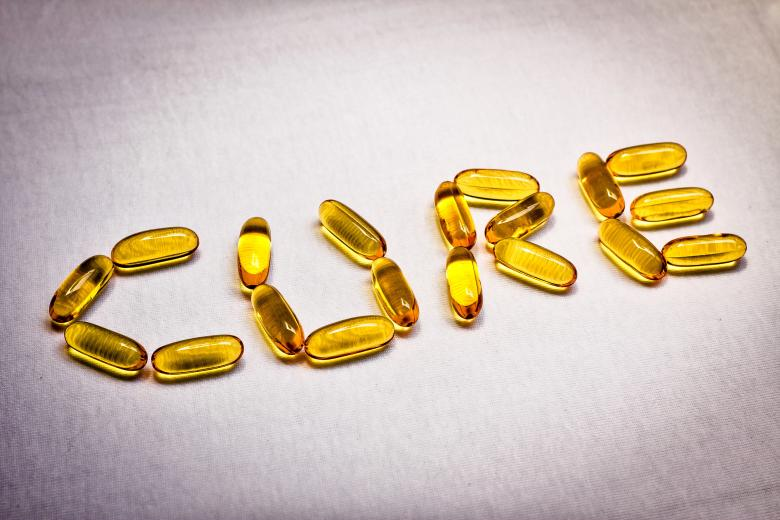 Free Stock Photo of Vitamin Captules Spelling the Word Cure Created by sapiduduk