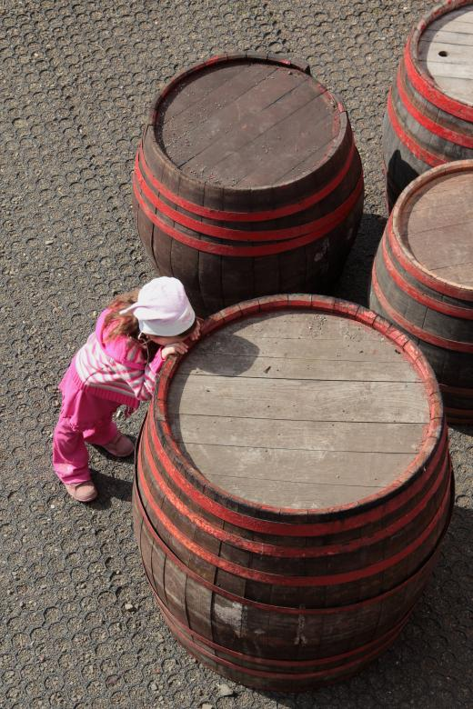 Free Stock Photo of Child leaning on barrel Created by Gusztáv Galló