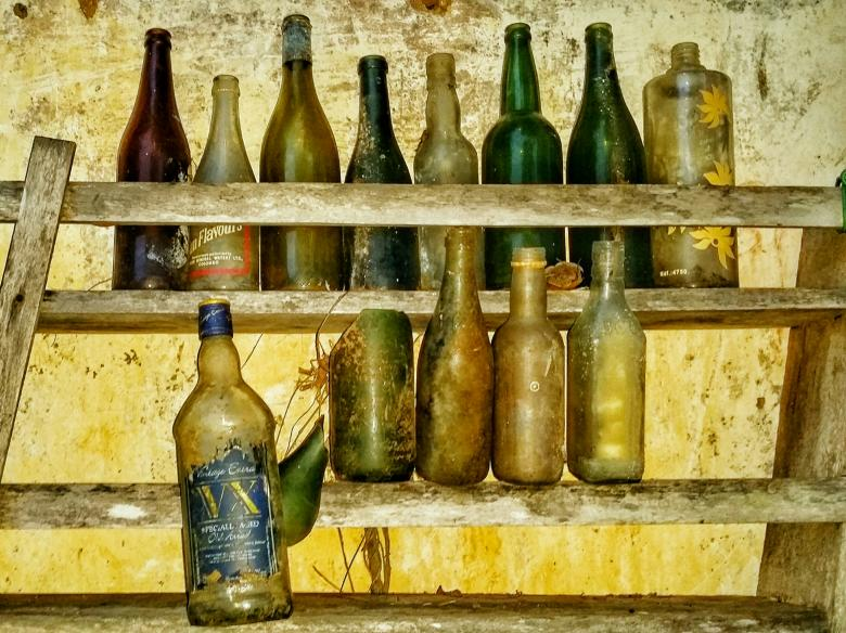 Free Stock Photo of Old Bottles in a rack Created by Nushrath Ahamed