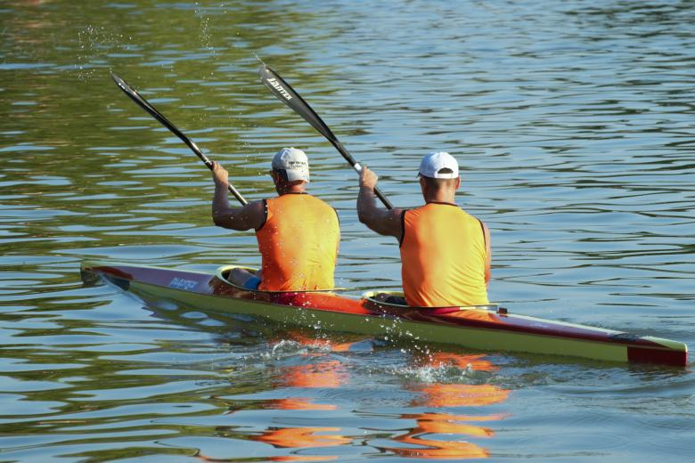 Free stock image of Young men rowing in a kayak created by Mircea Iancu