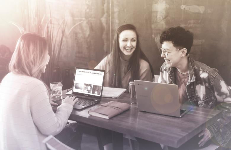 Free Stock Photo of Friends Smiling and Working with Laptops at a Cafe Created by Jack Moreh