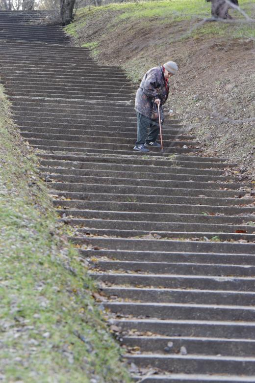 Free Stock Photo of Elderly woman descending stairs in park Created by Mircea Iancu
