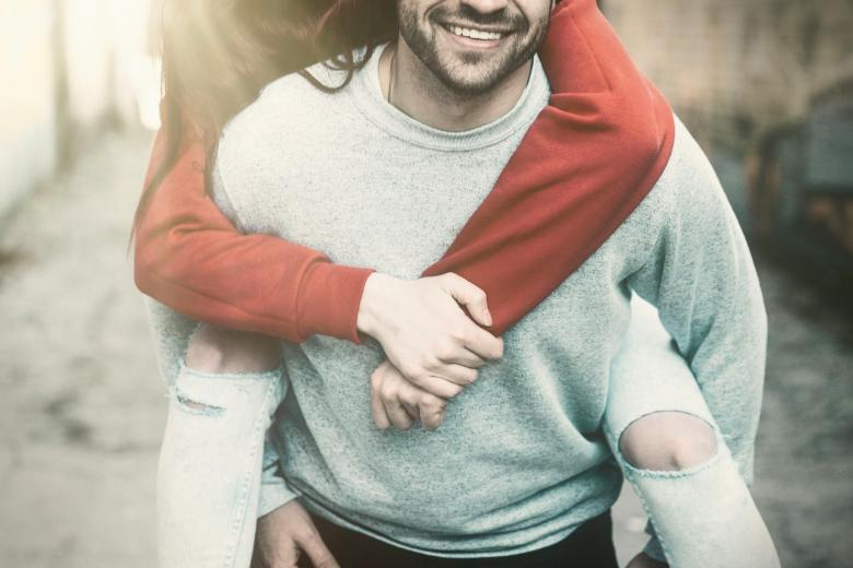 Free Stock Photo of Happy Loving Couple - Happy Young Man Piggybacking Girlfriend Created by Jack Moreh